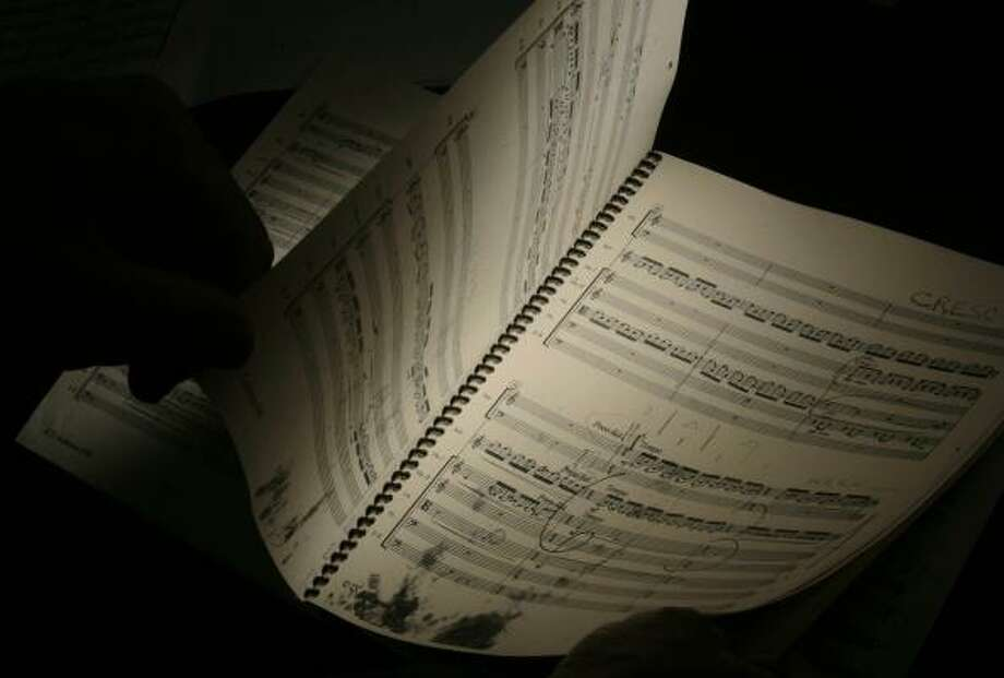 A copy of Dave Anderson's Concerto for double bass, strings and harp shows how the original work is marked by water damage yet salvageable. Photo: MAYA BELTRAN, CHRONICLE