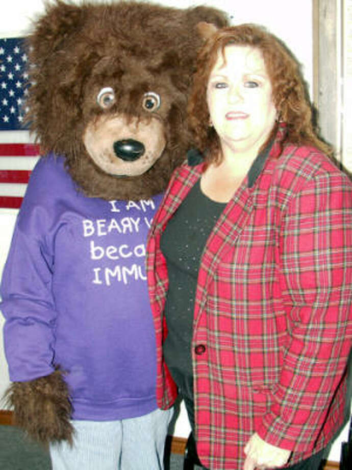 Meningitis Angels founder Frankie Milley, right, with Beary Wise, the organization's mascot on the left. Photo: Suzanne West, For The Chronicle