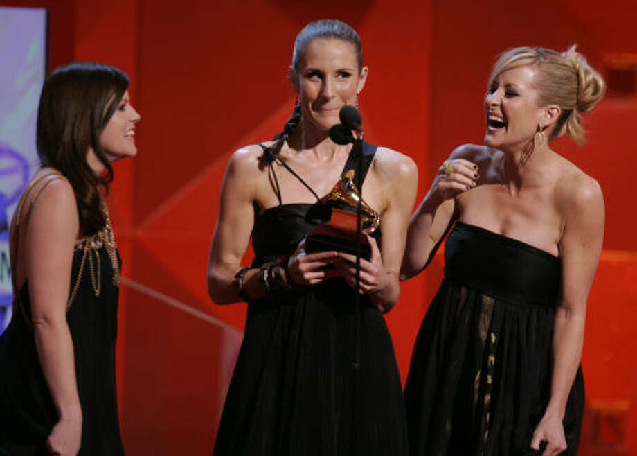 The Dixie Chicks' Natalie Maines, from left, Emily Robison, and Martie Maguire accept the Grammy award for best country album at the 49th annual Grammy awards on Sunday. Photo: Mark J. Terrill, AP