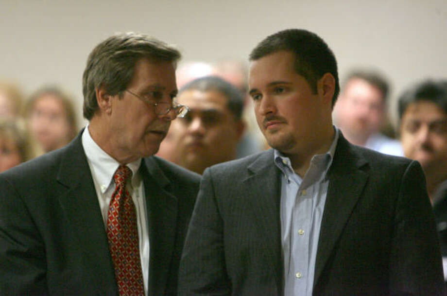 """Prosecutors painted Bart Whitaker, 27, right, with attorney Randy McDonald, as willing to kill to get his inheritance. """"He killed his family for money, stinking money,"""" a prosecutor told jurors. Photo: Bob Levey, For The Chronicle"""