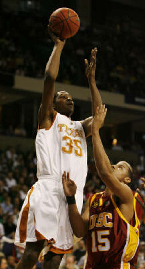 Texas' Kevin Durant (35) goes up over USC's Dwight Lewis in the first half of Sunday's East Regional game at Spokane, Wash. Durant scored 30 points and had nine rebounds, but it wasn't enough as the fifth-seeded Trojans breezed past the No. 4 Longhorns 87-68. Photo: James Nielsen, Chronicle