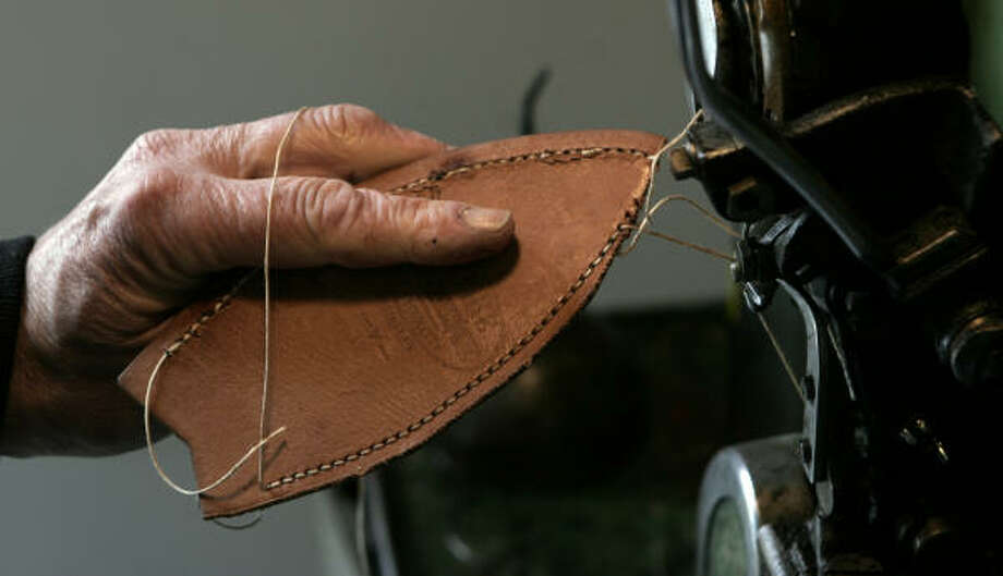Cobbler Bill Wheeler stitches a part of a shoe that he is repairing at his shop in Waldoboro, Maine. Photo: PAT WELLENBACH, AP