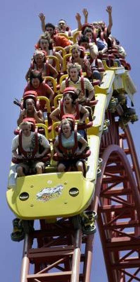 Riders scream as they go over a peak on the Storm Runner roller coaster at the Pennsylvania amusement park. Photo: CAROLYN KASTER, ASSOCIATED PRESS