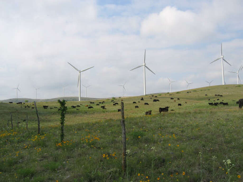 A contract negotiated by Houston officials would ensure that a third of the city's power would be generated by turbines similar to these seen at an Oklahoma wind farm. Photo: Horizon Wind Energy, Handout