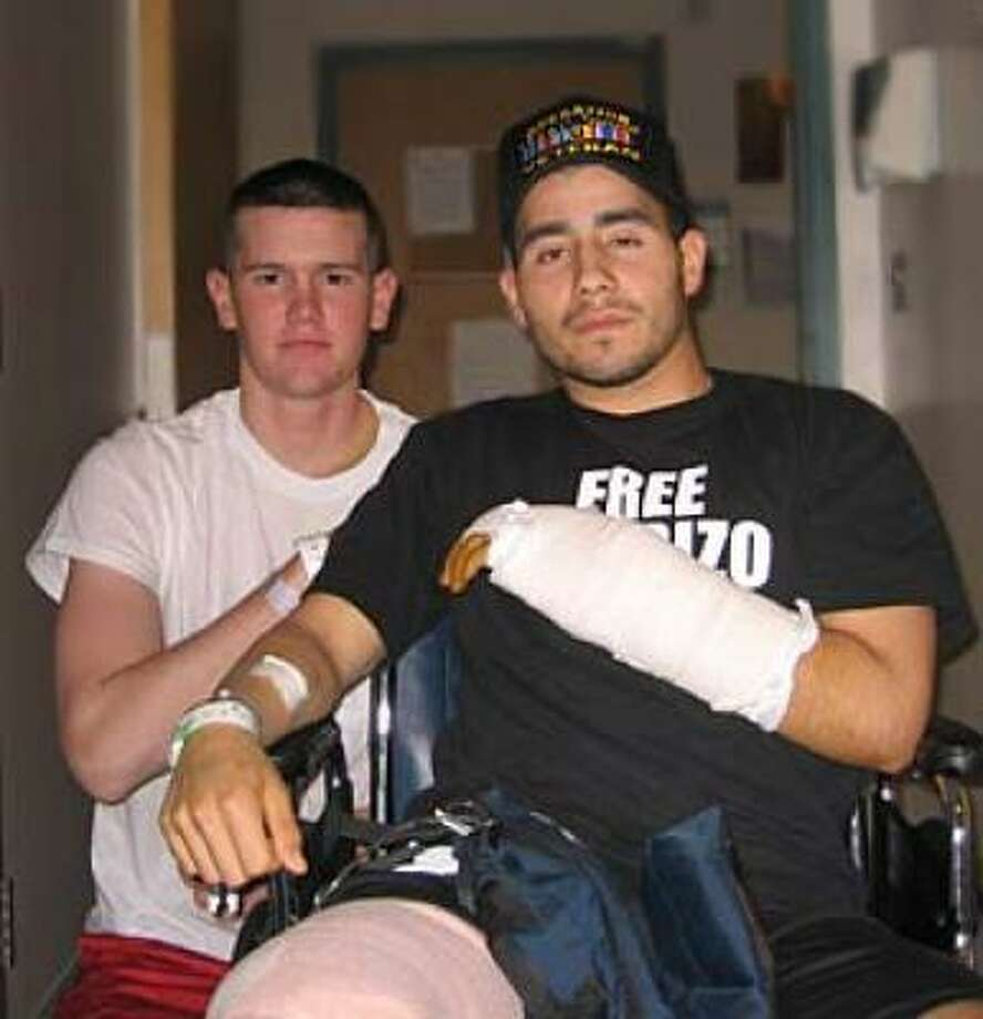 U.S. Marines Lance Cpl. Steven May, left, a 2005 graduate of Memorial High School, and Cpl. Eric Morante, 22, a 2003 graduate of Spring Woods High School, were injured in Iraq April 20 by an insurgent suicide attack. May suffered back injuries, a broken shoulder, fractured ribs, and the collapse of both lungs in the attack. Morante lost his right leg, sustained facial fractures and a shattered wrist. Photo: Julia May, Contributed Photo