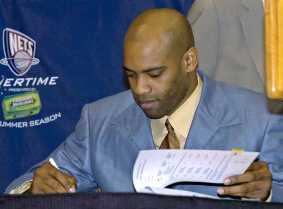 The New Jersey Nets gave guard Vince Carter $60 million reasons to be happy, signing the All-Star to a four-year deal. Photo: Bill Kostroun, AP