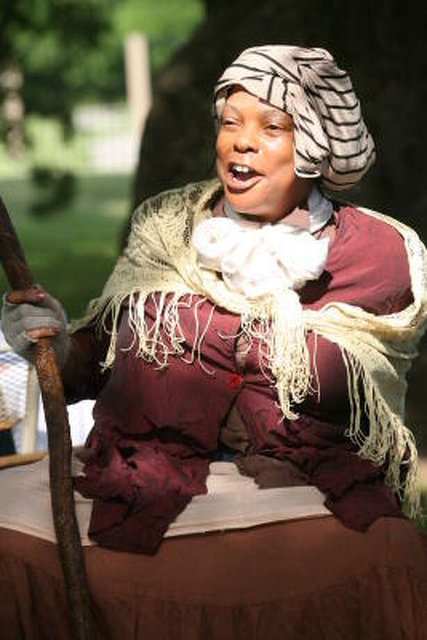 Melissa Waddy-Thibodeaux portrayed Harriet Tubman at a Juneteenth celebration in Missouri City on June 14. She serves as program director of free reading clinics sponsored by the Buffalo Soldiers National Museum and Flying Geese Productions from 9:30 a.m.-noon Saturdays through Aug. 11. Photo: Suzanne Rehak, For The Chronicle