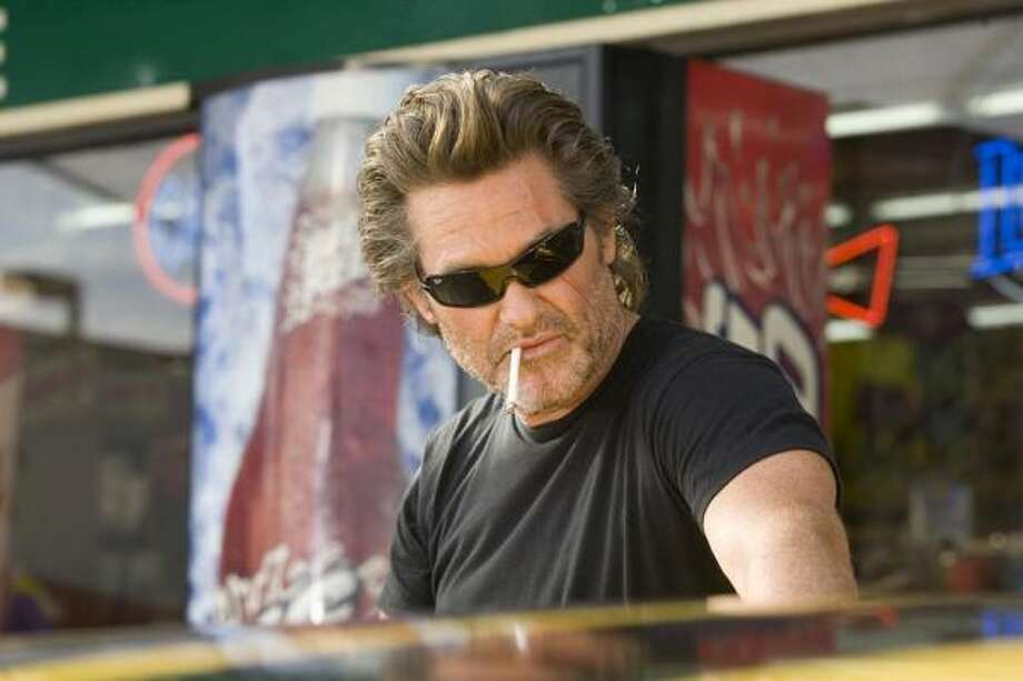 While Death Proof may have a female-empowerment theme, rest assured, it's still geared toward action geeks and car freaks. Kurt Russell stars in the Quentin Tarantino film, which is being released on DVD today. Photo: ANDREW COOPER, DIMENSION FILMS