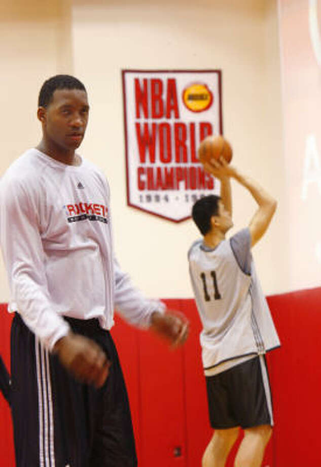 Tracy McGrady and Yao Ming play for one of the least-headline-grabbing teams in the NBA, and that's just fine with the players. Photo: Steve Ueckert, Chronicle