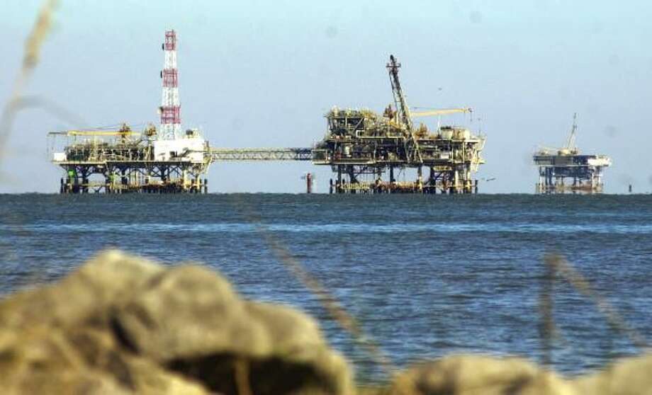 Exxon Mobil natural gas wells operate near Dauphin Island, Ala. The state's Supreme Court threw out most of a royalties verdict against the company. Photo: DAVE MARTIN, ASSOCIATED PRESS FILE