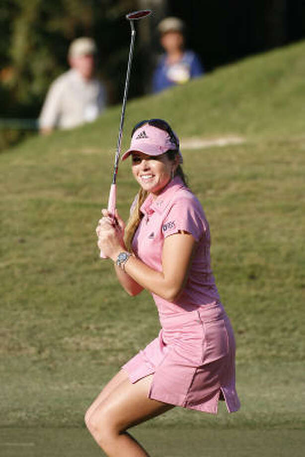 Paula Creamer watches as her birdie putt on the 18th hole rolls into the cup. Photo: Chip English, AP