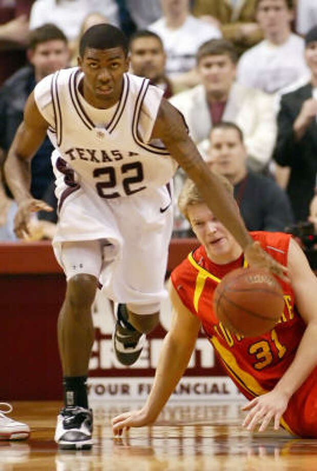 Texas A&M's Dominique Kirk grabs aloose ball in front of  Iowa State's Cory Johnson during the Aggies' 73-49 win in College Station. Photo: Paul Zoeller, AP