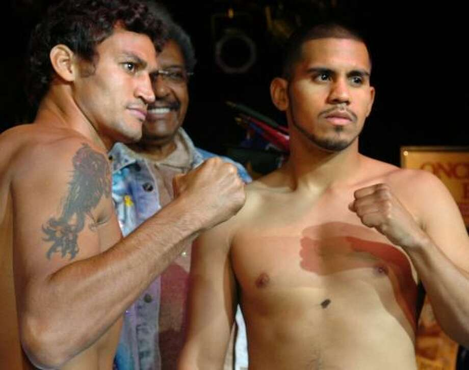 Juan Diaz, right, and Acelino Freitas are ready to get down to business tonight in Manhantucket, Conn. Photo: FRED BECKHAM, ASSOCIATED PRESS