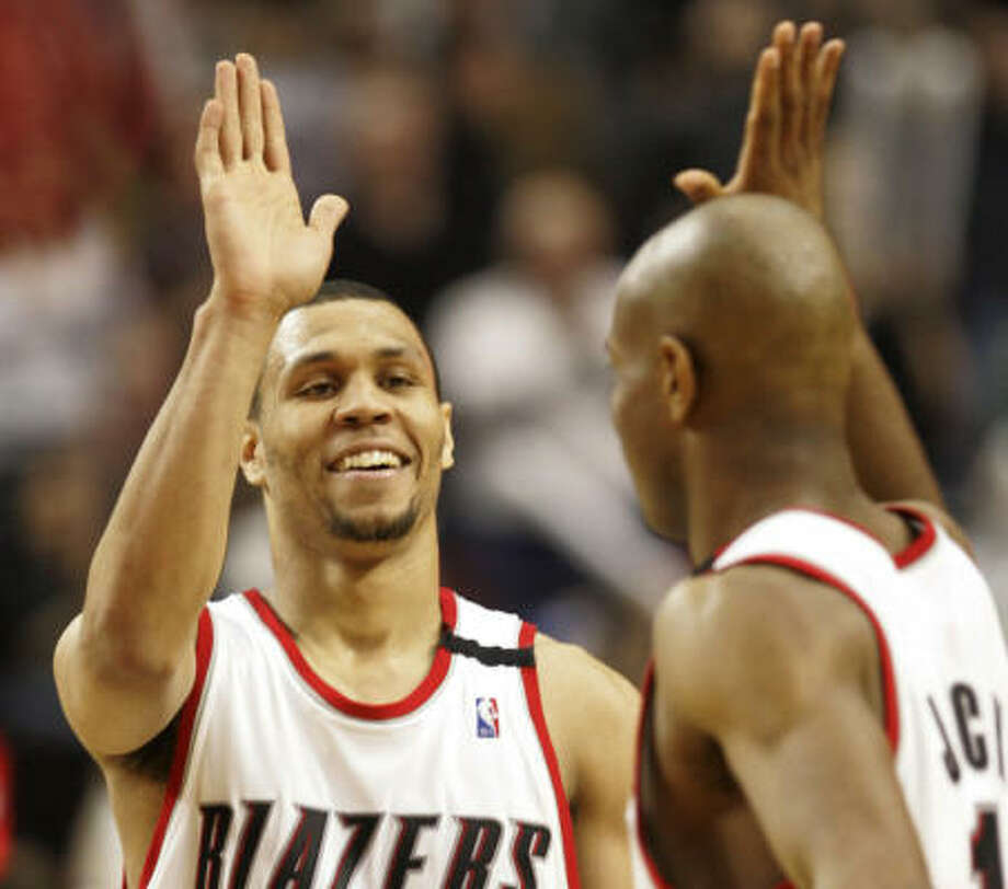 Portland's Brandon Roy, left, was rewarded for an outstanding debut season with the NBA's Rookie of the Year award on Wednesday. Photo: Rick Bowmer, AP