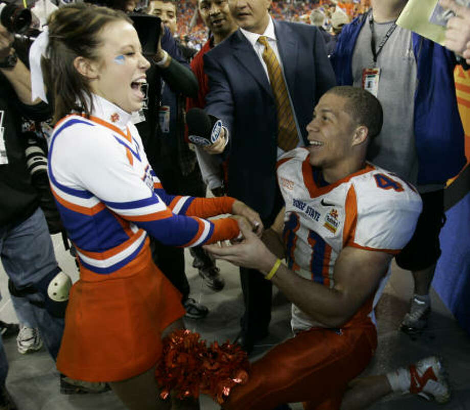 Boise State RB Ian Johnson and his fiance, Chrissy Popadics, have had their Saturday wedding marred by death threats, causing an upgrade in security for the date. Photo: Ted S. Warren, AP