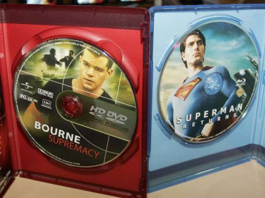 A video disc of The Bourne Supremacy, left, is programmed in the HD DVD format. Superman's Return is made for the competing high-definition format, Blu-ray. Photo: REED SAXON, ASSOCIATED PRESS