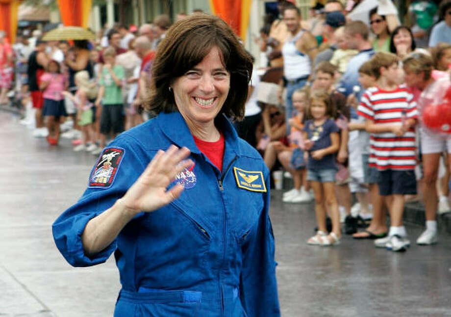 Astronaut Barbara Morgan waves to spectators during a walk down Main Street for NASA Space Day on Monday at Walt Disney World in Lake Buena Vista, Fla. Photo: John Raoux, AP