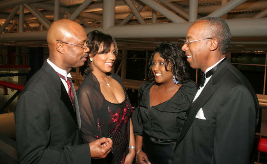 Bishop James and Tanisha Dixon, left, with Kimberly and Jamie House Photo: Gary Fountain, For The Chronicle