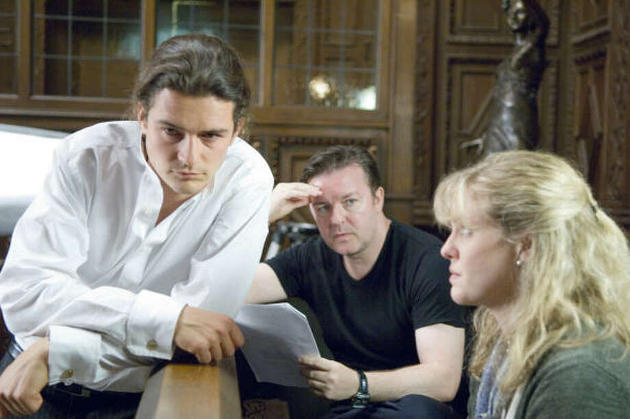 Orlando Bloom, left, plays version of himself on HBO's Extras, starring Ricky Gervais, center, and Ashley Jensen, that doesn't believe a woman would not be enamored with him. Photo: HBO