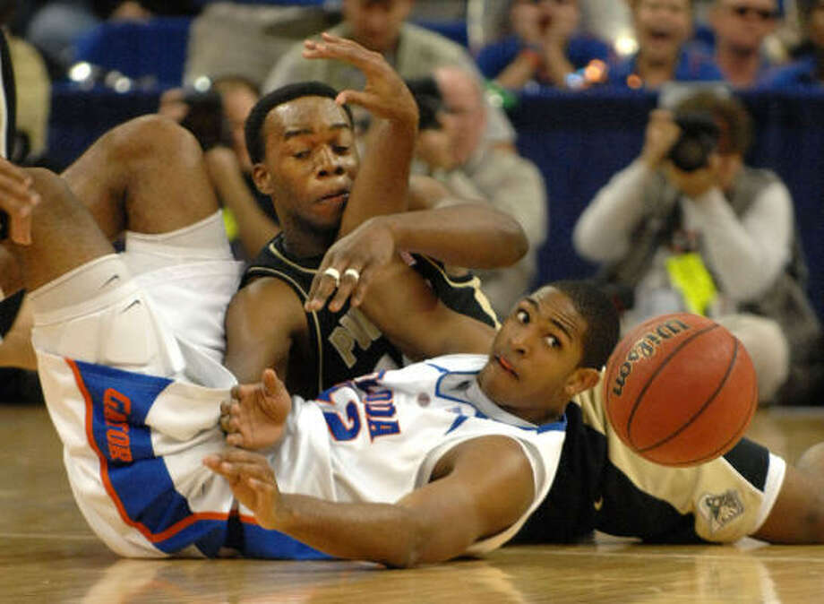 Florida's Al Horford, front, and Purdue's Carl Landry battle for control of the ball in the first half of Sunday's Midwest Regional game. The top-seeded Gators won 74-67. Photo: Bob Self, AP