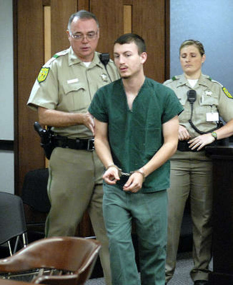 Joshua Mauldin, 19, is led into Judge Susan Criss 212th District Courtroom for his arraignment. Mauldin is accused of placing his baby in a hotel safe as well as putting her into the microwave and starting it for 10 to 20 seconds at a local hotel in Galveston. Photo: Kim Christensen, For The Chronicle