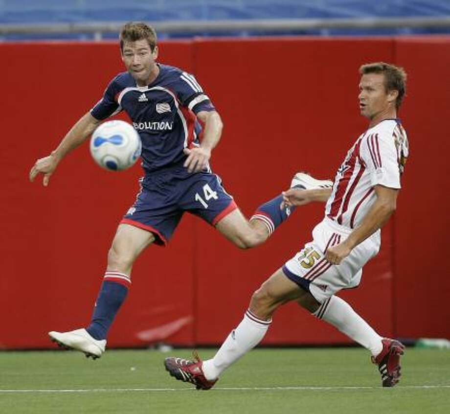 The Dynamo will try to intercept the passes of MLS career assist leader Steve Ralston (in blue) of New England. Photo: Michael Dwyer, AP