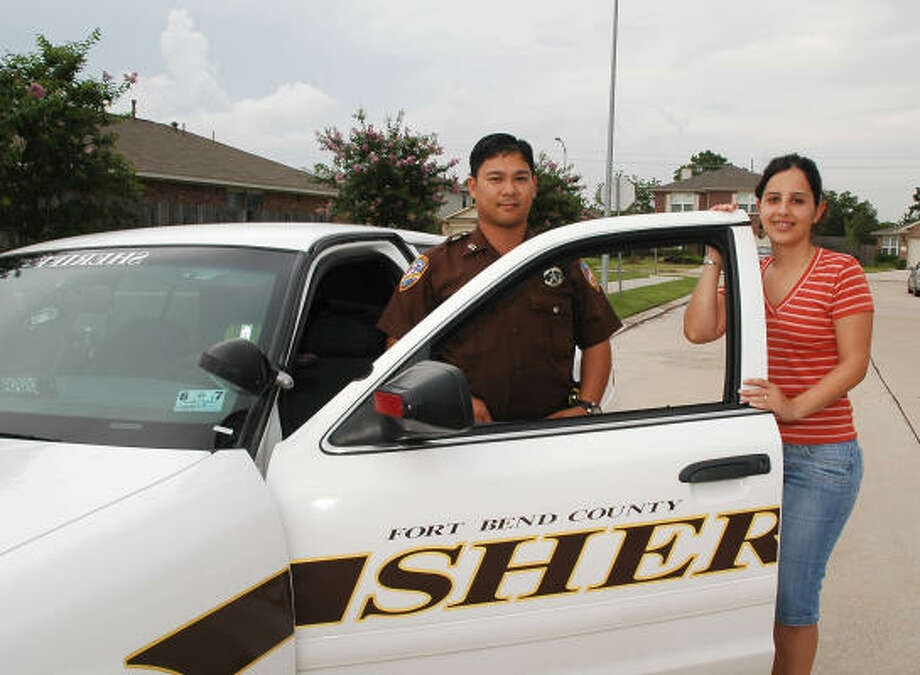Deputy Gerard Argao of Fort Bend County Sheriff's office and Sugarfield resident Claudia Goncalves will hold National Night Out events in unincorporated areas of Fort Bend. Photo: George Wong, For The Chronicle