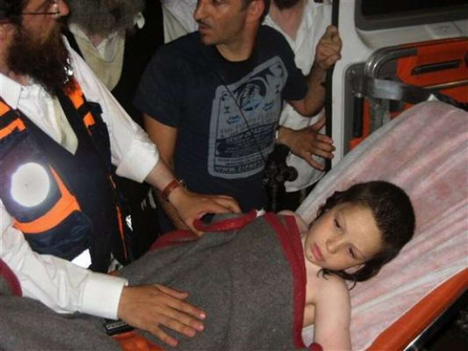 Rescuers place 8-year-old Shneur Zalman Friedman into an ambulance near the Dead Sea on Friday. Photo: Zaka, Religious Rescue Workers