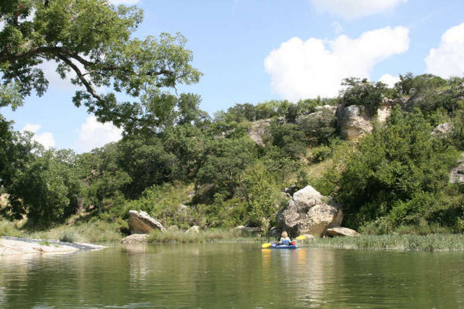 The San Saba River near Menard offers paddlers a quiet path filled with fish and mild rapids, among other things. Photo: Houston Chronicle