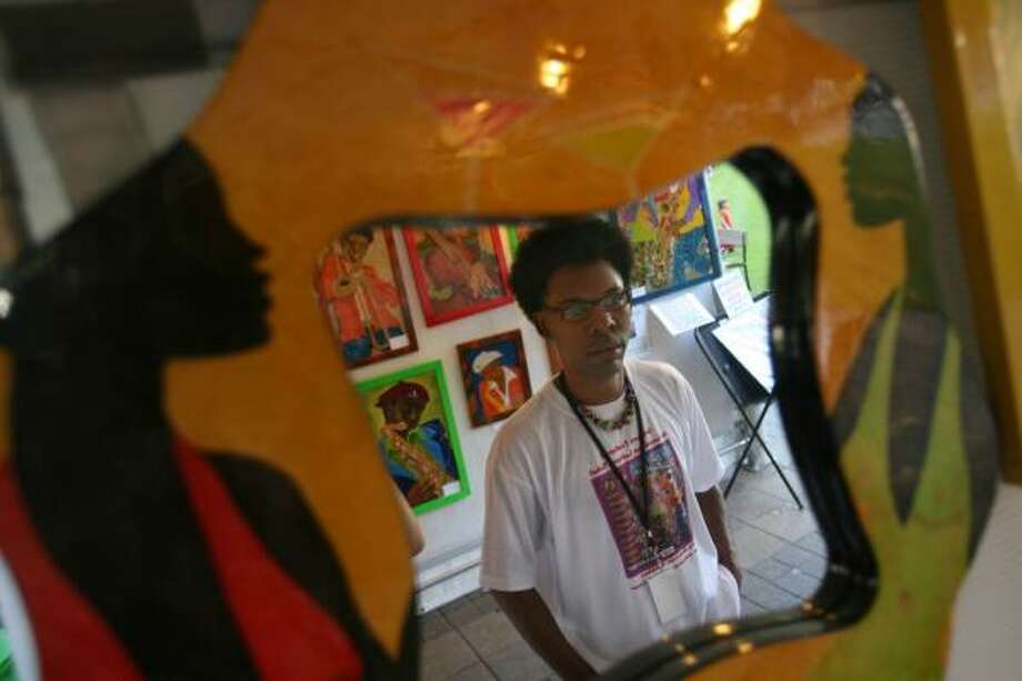 New Orleans-based artist Darrin Butler has produced work that will appear on Louisiana lottery tickets in December. Butler is one of 300 artists taking part in this year's Bayou City Art Festival Downtown. Photo: MAYRA BELTRÁN, CHRONICLE