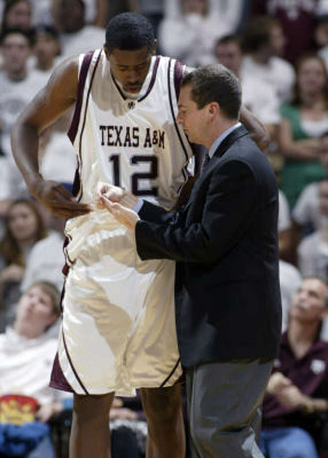 Texas A&M coach Mark Turgeon talks with center DeAndre Jordan during the second half. Jordan has made 16 straight field goals over the last four games to break the previous record of 13, set by Nebraska's Mikki Moore in three games in 1998. Photo: Paul Zoeller, AP