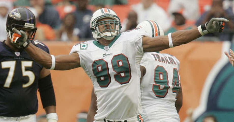 Dolphins defensive end Jason Taylor celebrates after one of his two sacks in the first half of Miami's first win. Photo: J. Pat Carter, AP