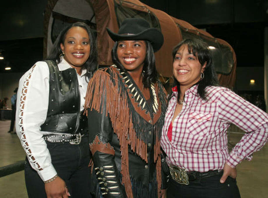 Jakki Dargin, from left, Charlotte Morning and Markitha Labbe step out in fine Western threads for the Houston Livestock Show and Rodeo Black Heritage Committee gala Saturday at Reliant Arena. Photo: Gary Fountain, For The Chronicle