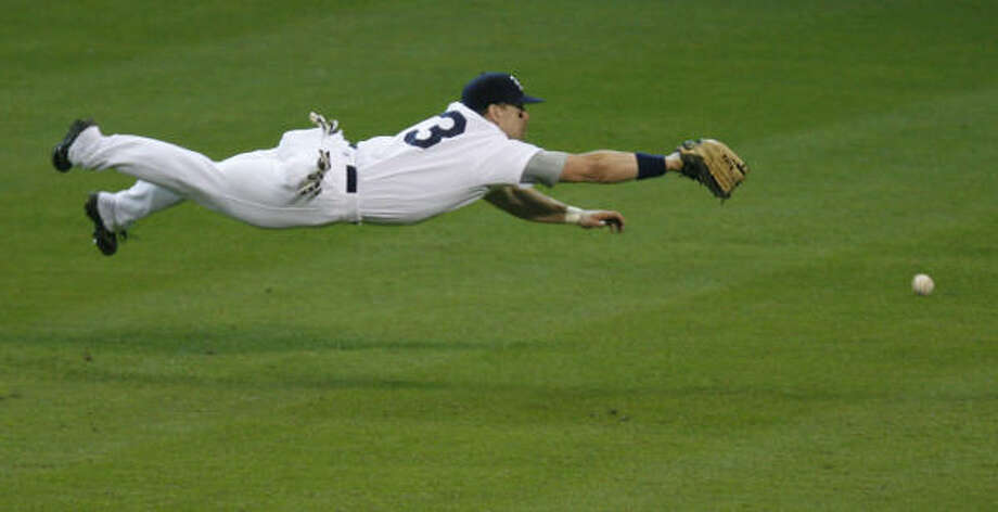 Rice outfielder Tyler Henley dives for a ball during the sixth inning. Photo: James Nielsen, Chronicle