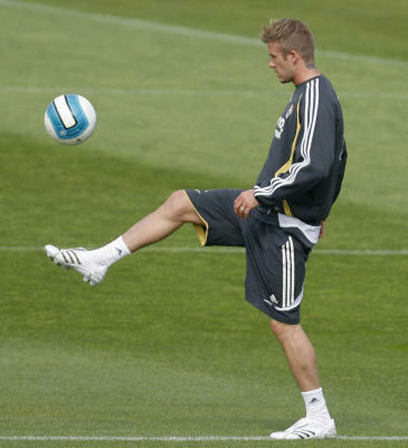 The L.A. Galaxy recently signed Real Madrid's David Beckham to a five-year, $250 million dollar contract that includes bonuses and endorsements. Photo: DANIEL OCHOA DE OZLA, AP