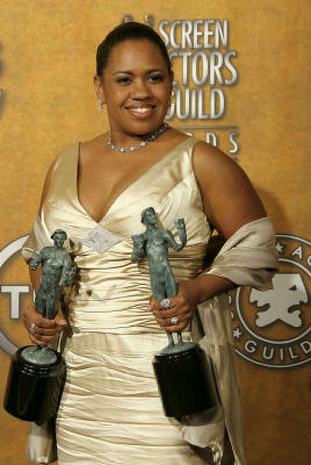 Houston native Chandra Wilson, who began her acting career at TUTS at the age of 5, holds the 2006 Screen Actors Guild awards she received in January for portraying Dr. Miranda Bailey on Grey's Anatomy. Photo: Vince Bucci, Getty Images