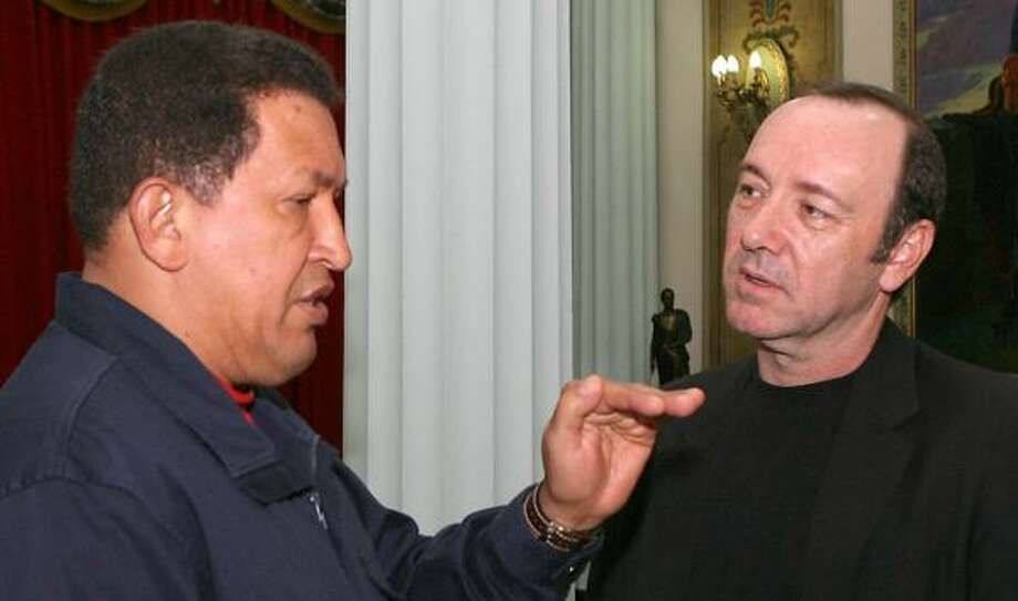 Actor Kevin Spacey talks to Venezuelan President Hugo Chavez in Caracas this week. Photo: MIRAFLORES PRESS OFFICE