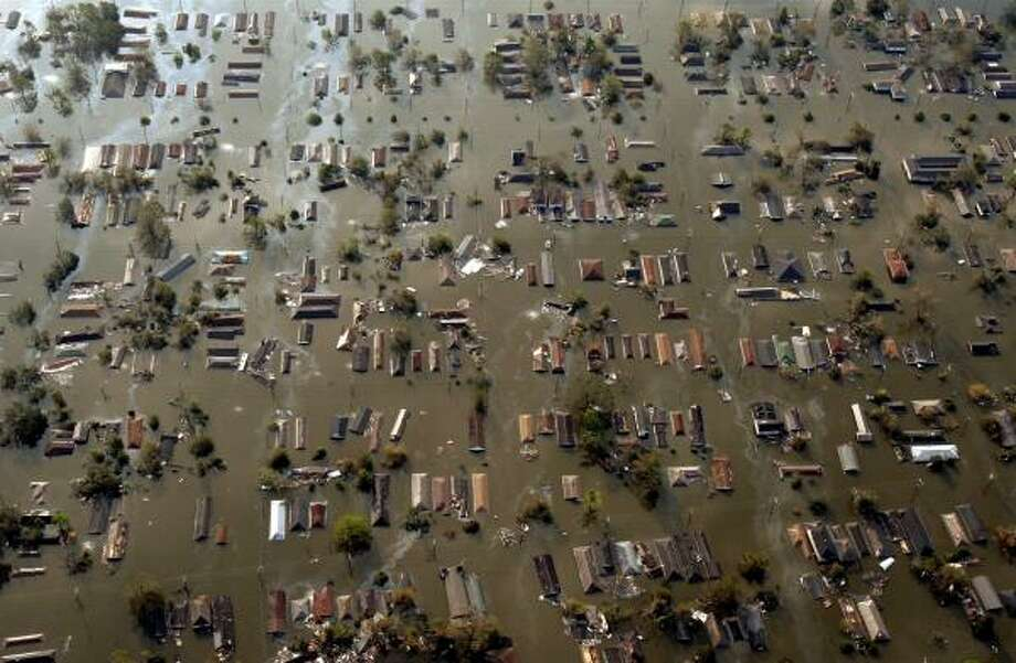 Water surrounds homes east of downtown New Orleans after Hurricane Katrina made landfall in August 2005. The U.S. House voted to strengthen the national flood insurance program that provides affordable coverage to homeowners in flood-prone areas. Photo: SMILEY N. POOL, ASSOCIATED PRESS FILE