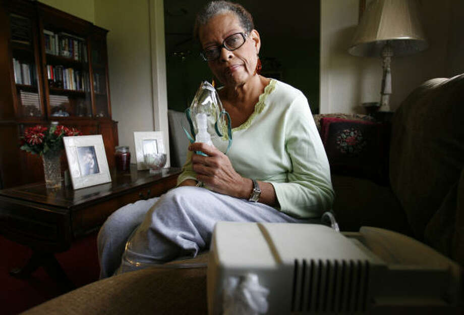 Vernitta Alexander, 55, recently displays the electric powered nebulizer she must use three times a day to treat her asthma in her Houston home.  Alexander is disabled and retired and has been trying to get help paying her electric bills. She had some help last year when her bills were close to $700. This year her bills aren't so high, but she's not able to get help unless she has a shut-off notice. Photo: Sharon Steinmann, Chronicle