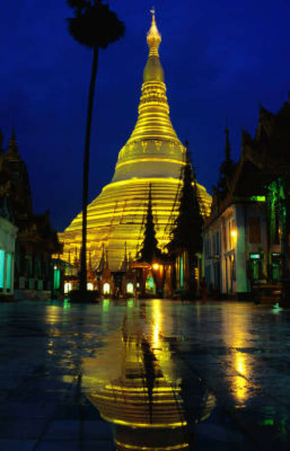 Visit Yangon's Shwedagon Paya at twilight, when the golden temple is illuminated and the fresh cool of evening is settling in. Photo: Anthony Plummer, Lonely Planet Images