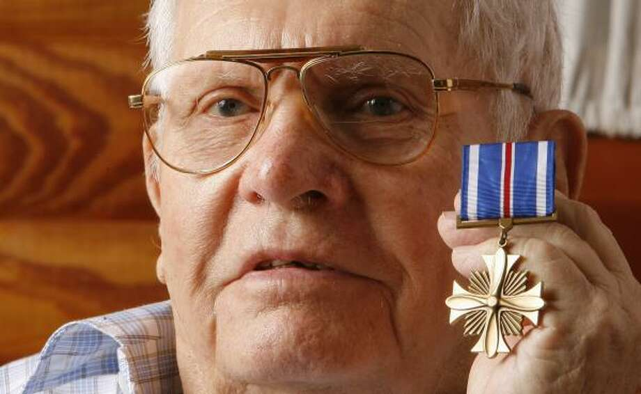 "Robert Bricker of Moss Bluff served 50 combat missions as an Army Air Corps navigator during World War II. Although he was up for the Distinguished Flying Cross at the end of his service, the award never came. ""  ...  After so many years passed, I'd about given up hope,"" he says. Photo: STEVE CAMPBELL PHOTOS, CHRONICLE"