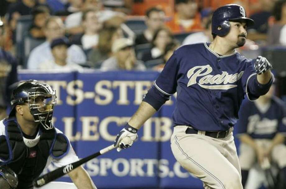 Adrian Gonzalez follows through on a homer in the 10th inning that lifted the Padres to victory. Photo: FRANK FRANKLIN II, ASSOCIATED PRESS