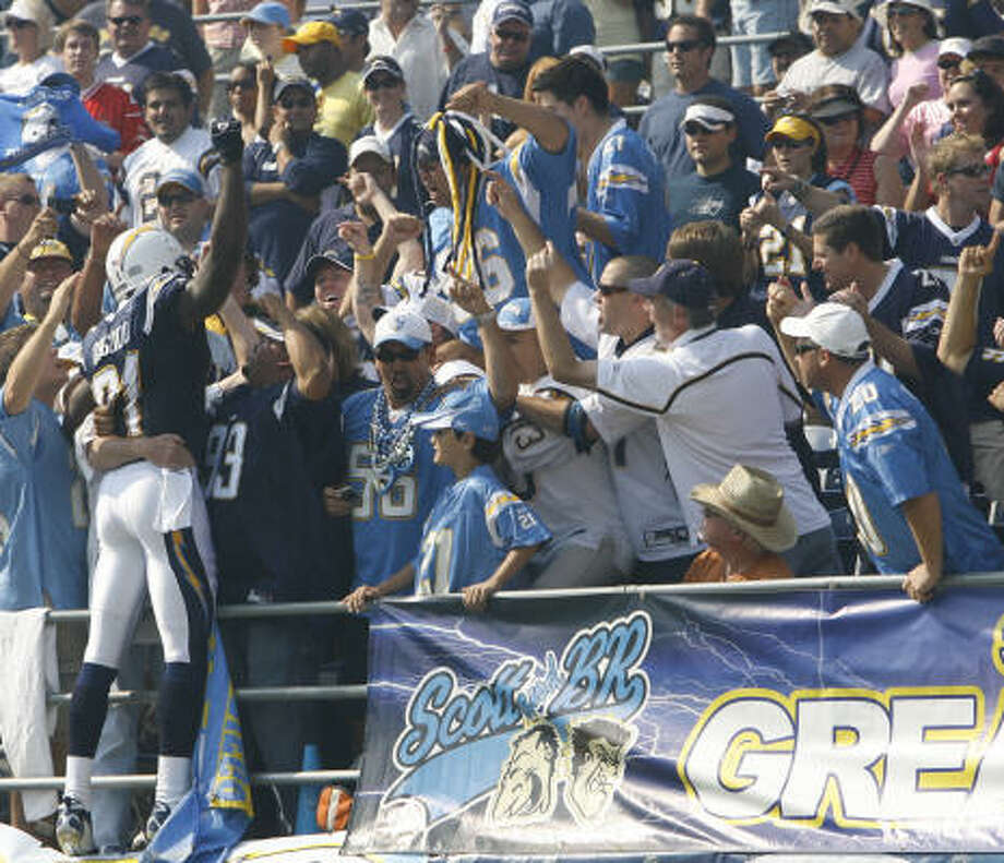 San Diego  wide receiver Kassim Osgood (81) jumps into the crowd at Qualcomm Stadium before the game. Photo: Kevin Fujii, Chronicle