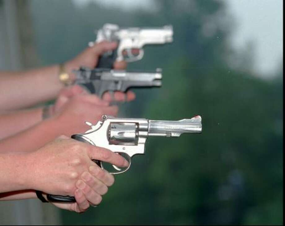 A Senate panel on Tuesday approved a bill, fiercely opposed by businesses, that gives workers the right to lock concealed handguns in their cars, even if the parking lot is owned by their employer. Photo: BOB BIRD, AP