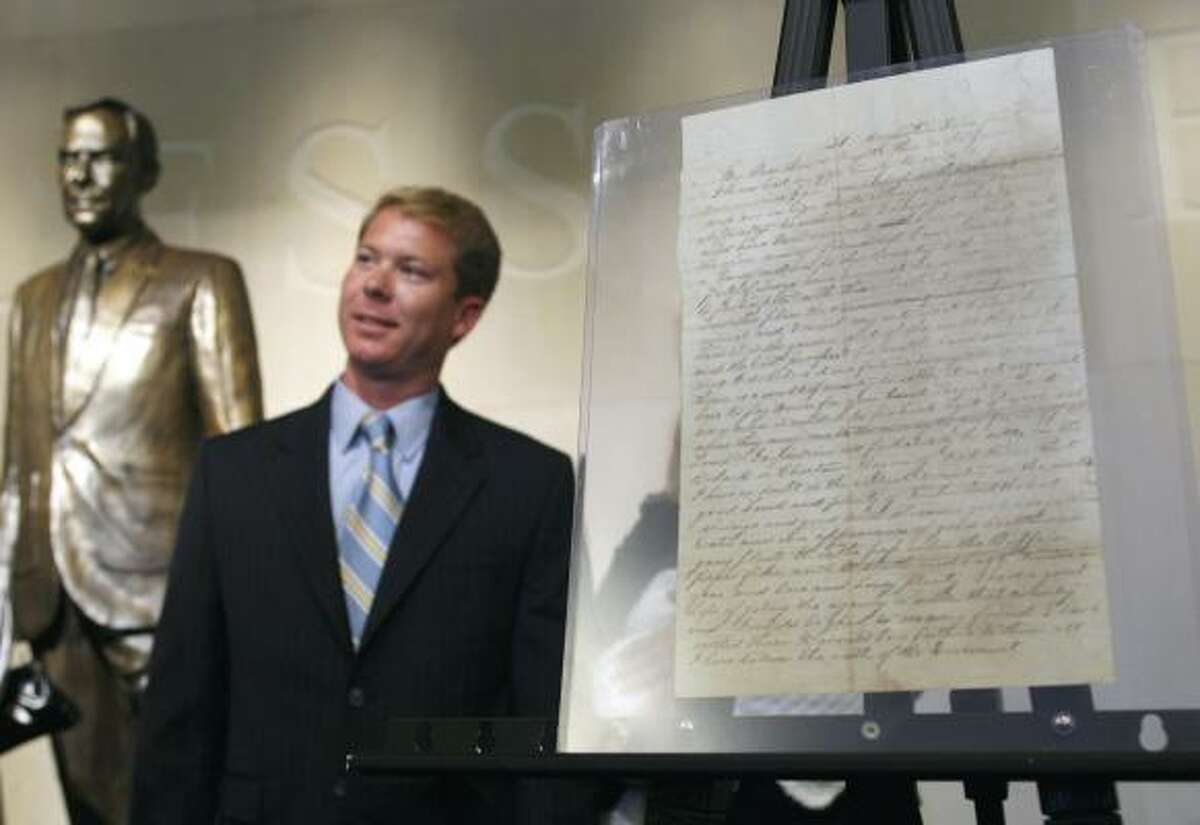 Houstonian Ray Simpson, who discovered the document in a file folder, turned it over Tuesday at the Bob Bullock Museum.