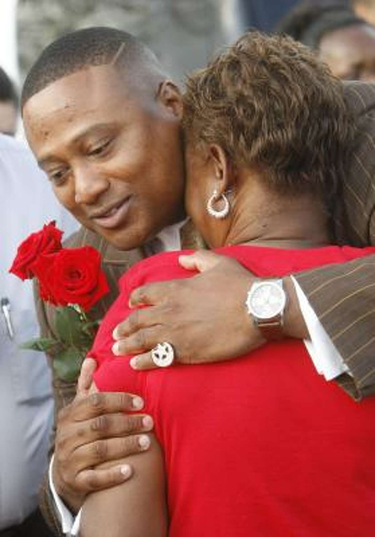 Quanell X hugs Gale Shields, Tynesha Stewart's mother, at a candlelight vigil on Thursday. Suspect Timothy Wayne Shepherd led Quanell X to where Shepherd said he dumped Stewart's body.