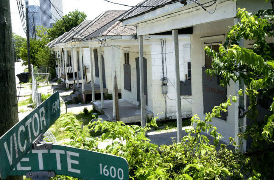 The 1500 block of Victor Street consists of 10 shotgun-style homes on one side and the Victory Apartments on the other. Photo: Jessica Kourkounis, For The Chronicle