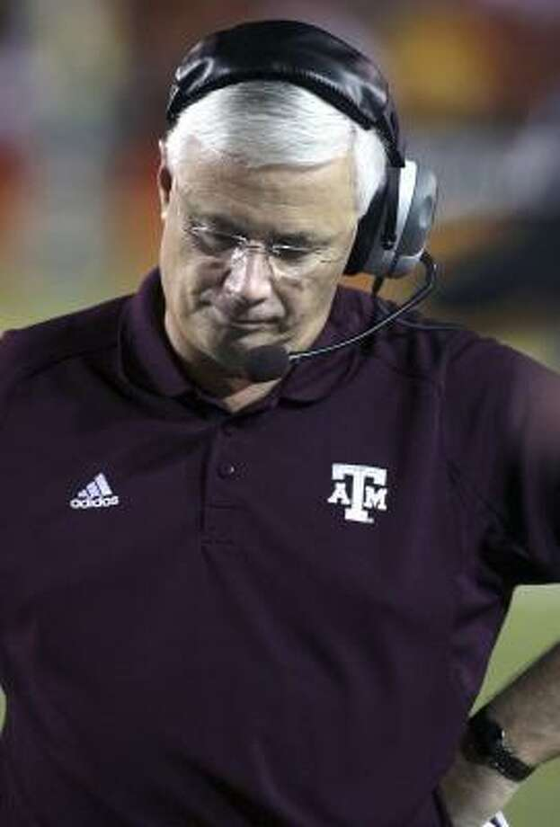Texas A&M coach Dennis Franchione was upset about a Mike Goodson fumble in the second quarter against Miami, but the evening was only starting to go downhill for the Aggies. Photo: LUIS M. ALVAREZ, ASSOCIATED PRESS