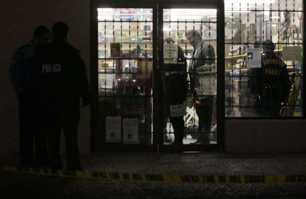 The shooting occurred about 5:40 p.m. when a man tried to rob the store owner by threatening him with a long-barrel rifle.