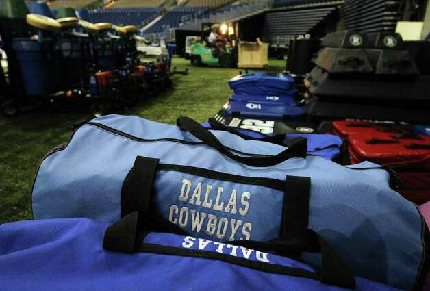 Movers take piles of equipment out of the Alamodome as the Dallas Cowboys training camp comes to a close on Tuesday, Aug. 9, 2011. Kin Man Hui/kmhui@express-news.net Photo: KIN MAN HUI, -- / SAN ANTONIO EXPRESS-NEWS